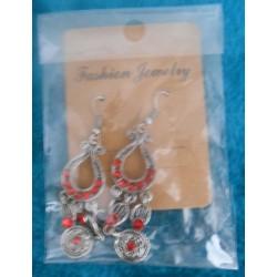 Boucles d'oreilles harpe rouge emballées